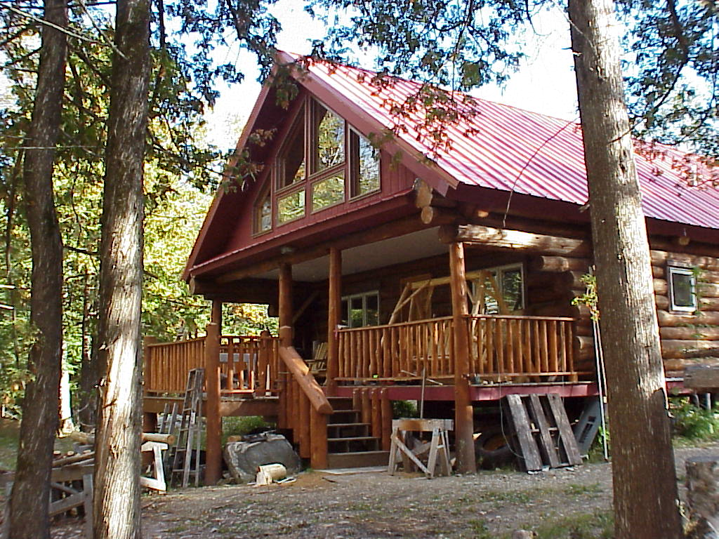 Front View Ely Island private log cabin for rent, for sale
