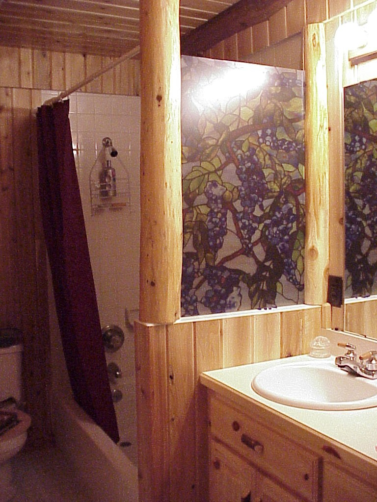 Bathroom of private log cabin for rent or for sale